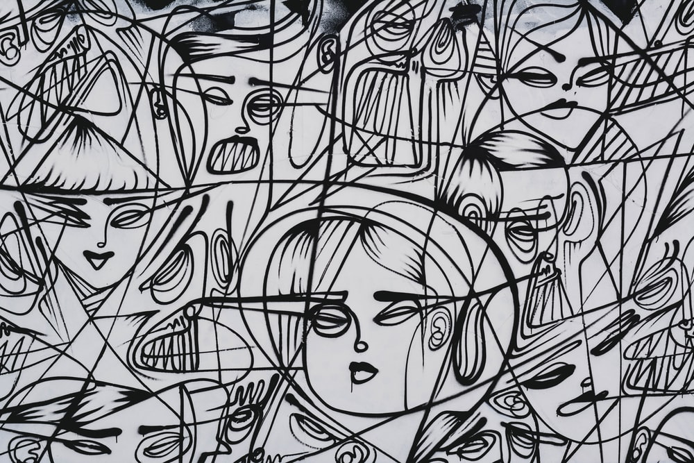 a drawing of patterns and faces